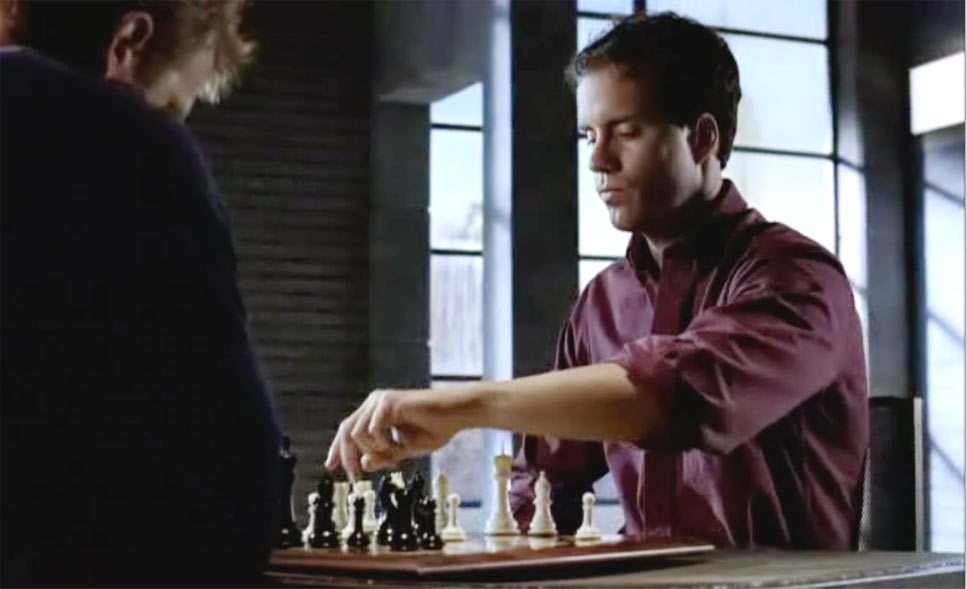 Man making a chess move